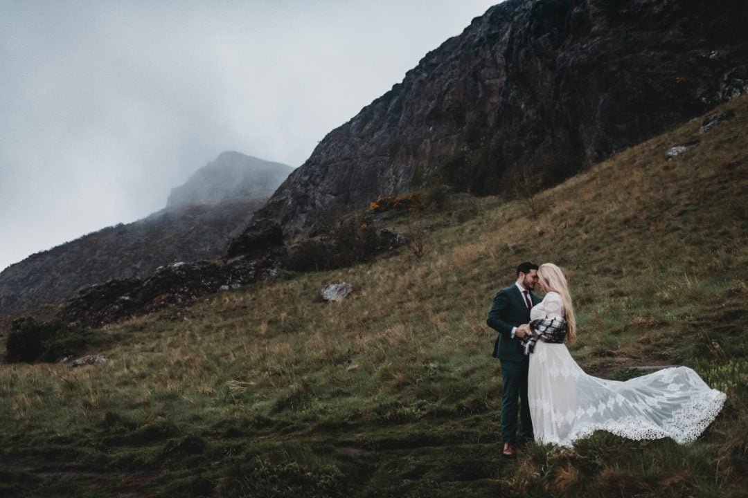 Kait and Phil, Edinburgh elopement - Arthur's Seat in Holyrood Park in the rain and misty foggy hills