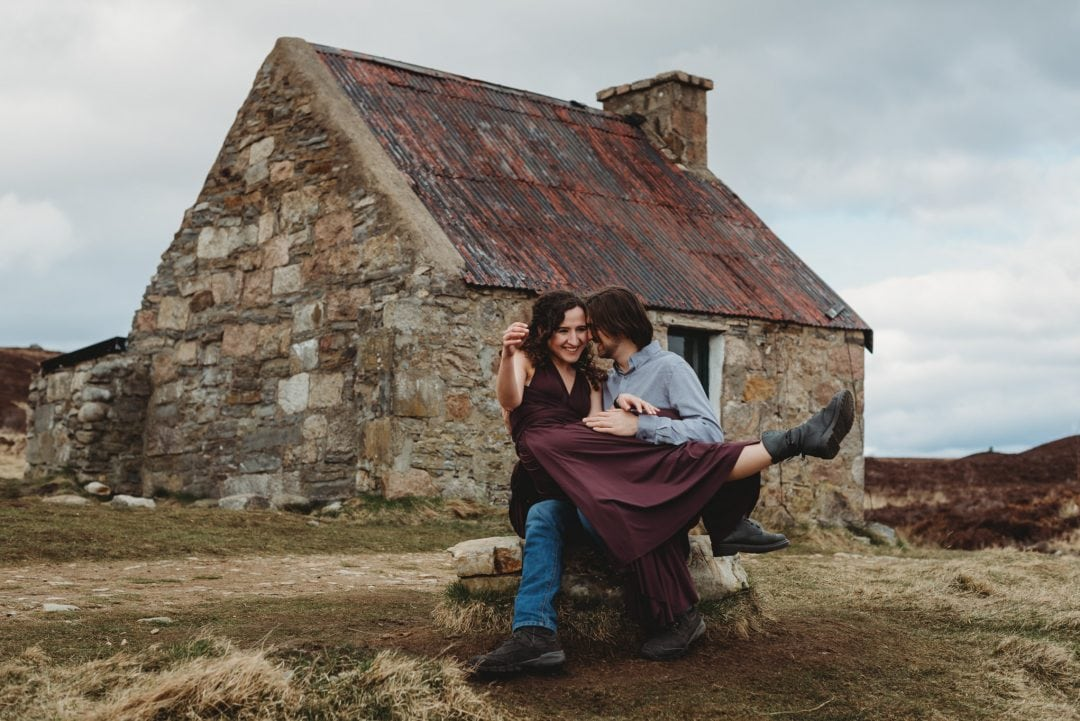 happy couple by bothy - elopement adventure session, Cairngorms