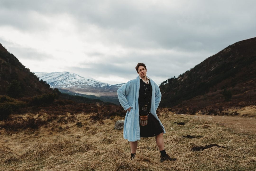 Man in kilt in Cairngorms, Highlands, silly
