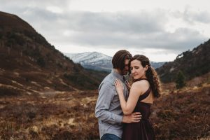 Aviemore romantic couple looking over vista in the Cairngorms