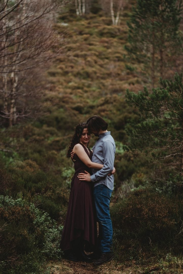 Cuddling amongst trees - couples session in the Cairngorms, Scottish Highlands