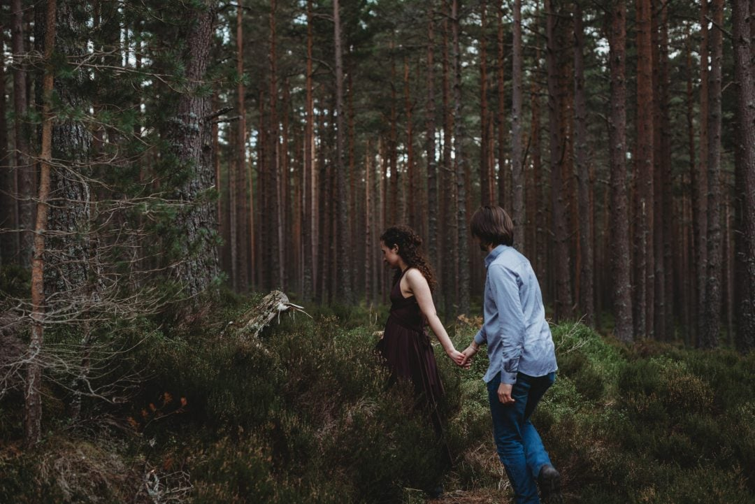 Walking through trees - couples session in the Cairngorms, Scottish Highlands