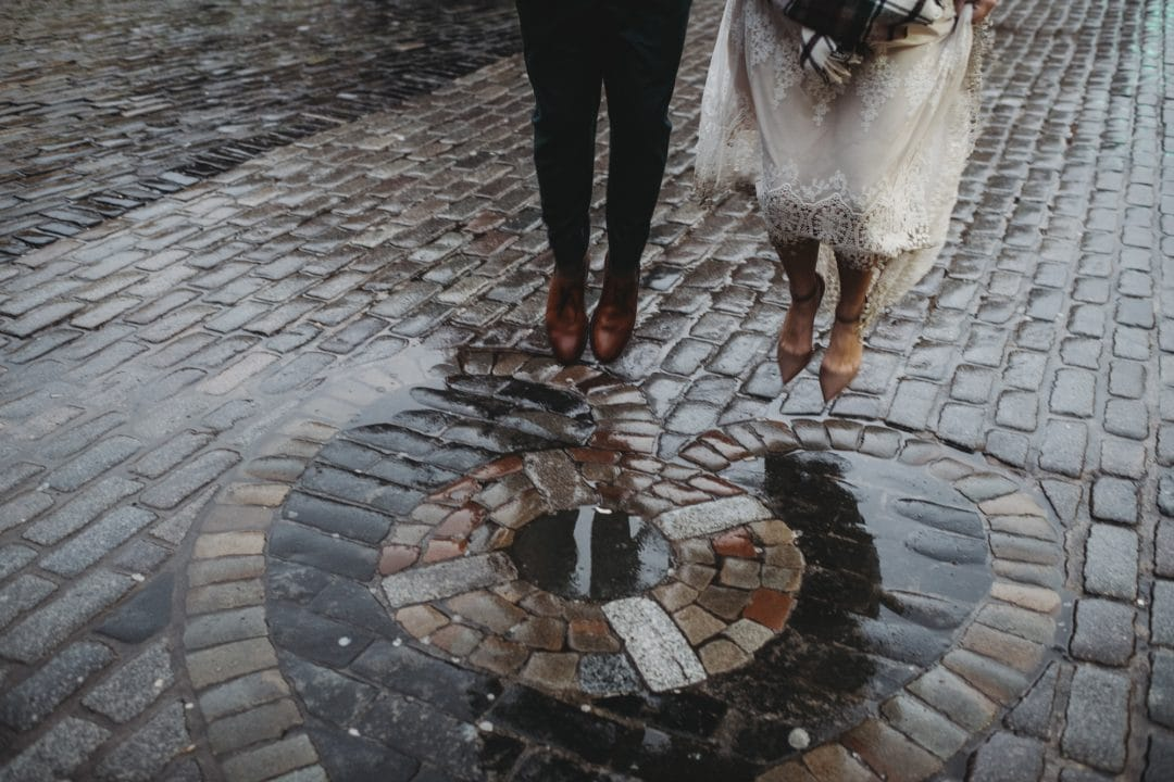 adventure elopement couple jumping on the Heart of Midlothian, Edinburgh