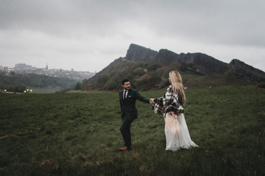 adventure elopement couple in foggy holyrood park, Edinburgh