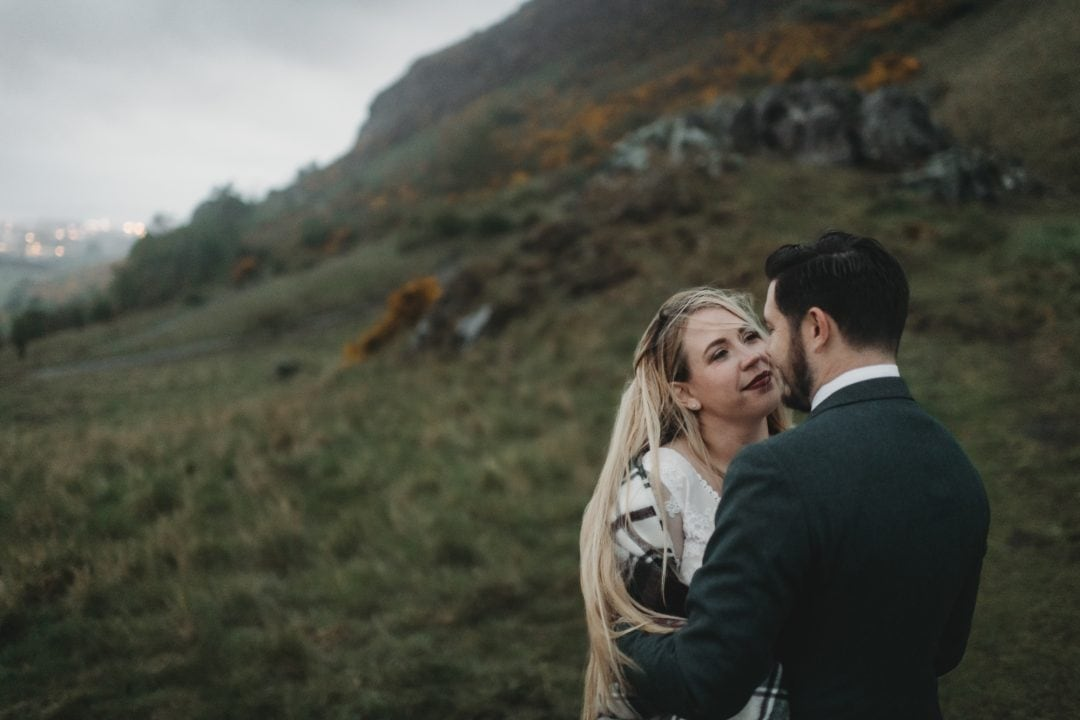 elopement couple in foggy holyrood park, Edinburgh