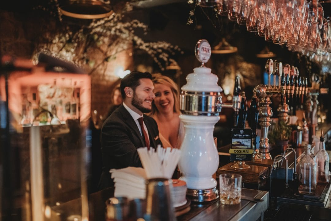 happy elopement couple in Scottish pub bar