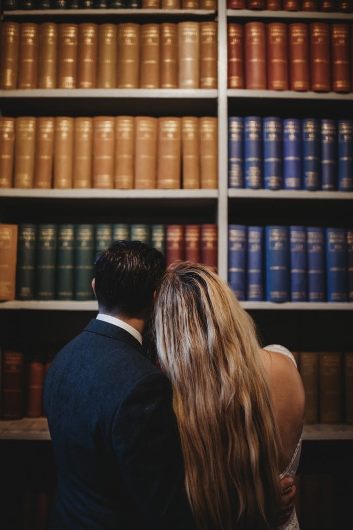 Adventure elopement couple inside Signet Library in Edinburgh city centre - books