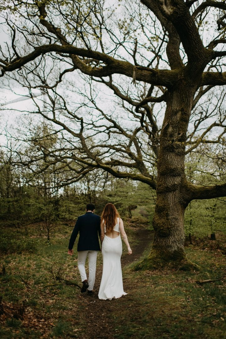 American couple eloping in Scottish Highlands