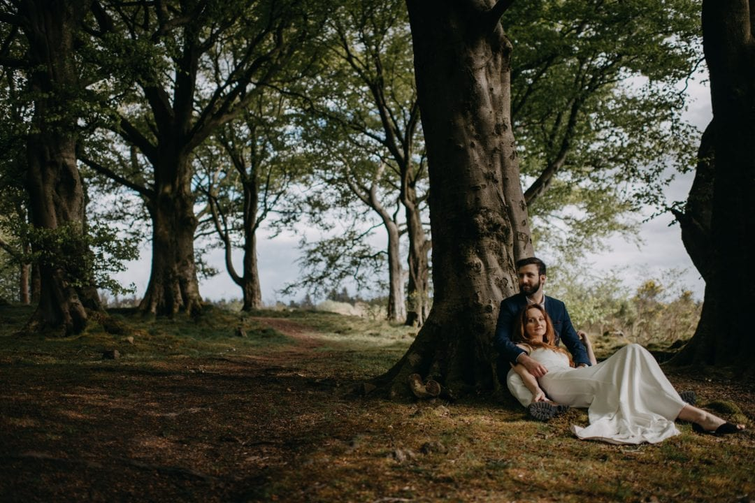 Couples shoot in nature Scotland by trees. Lena Sabala and Patrick Zaarour on Mark Pacura workshop.