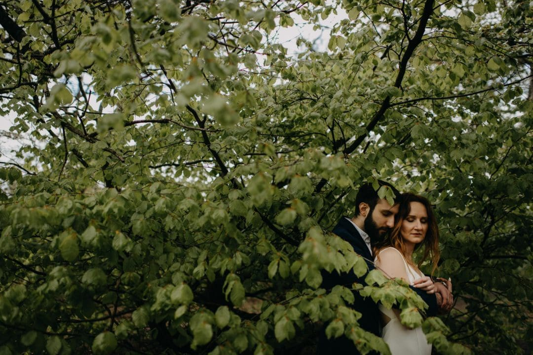 Couple shoot in nature Scotland by trees. Lena Sabala and Patrick Zaarour on Mark Pacura workshop.
