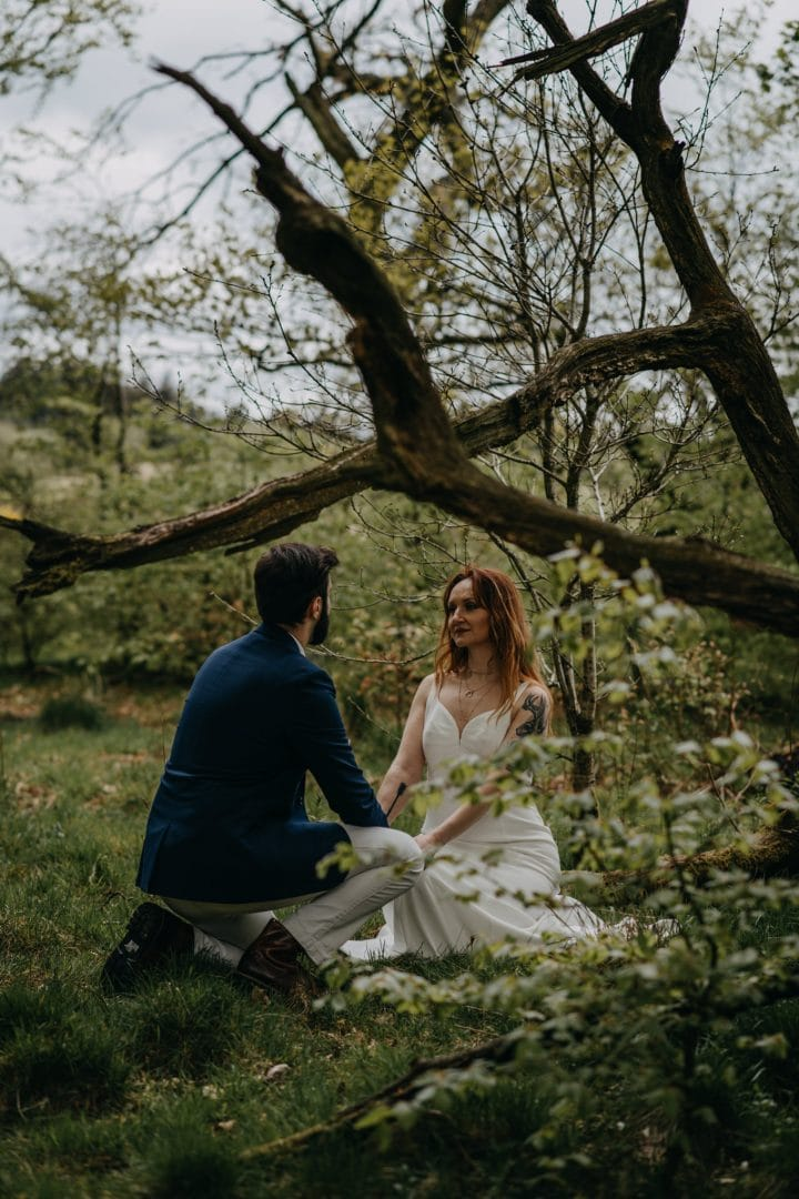 Elopement couples shoot in nature Scotland on vacation - making vows under tree