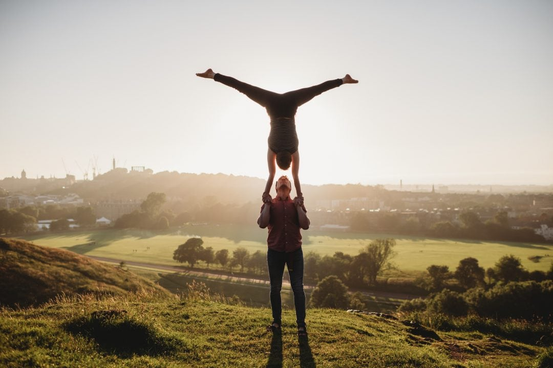 Acrobalance couple during couples connection photoshoot in Edinburgh - Holyrood Park