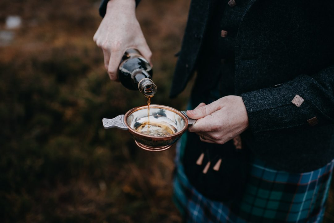 pouring mead into a Scottish quaich