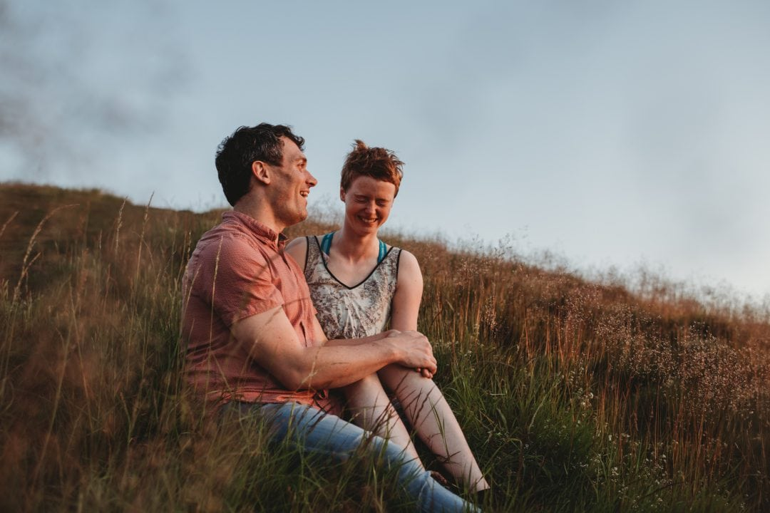 Couple laughing together in Holyrood Park
