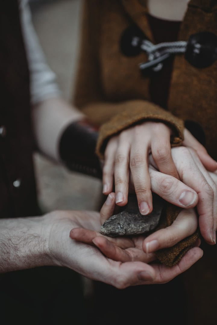 Oathing stone - hands holding