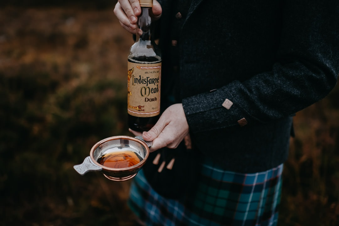 Quaich with lindisfarne mead in Glencoe - Scottish tradition