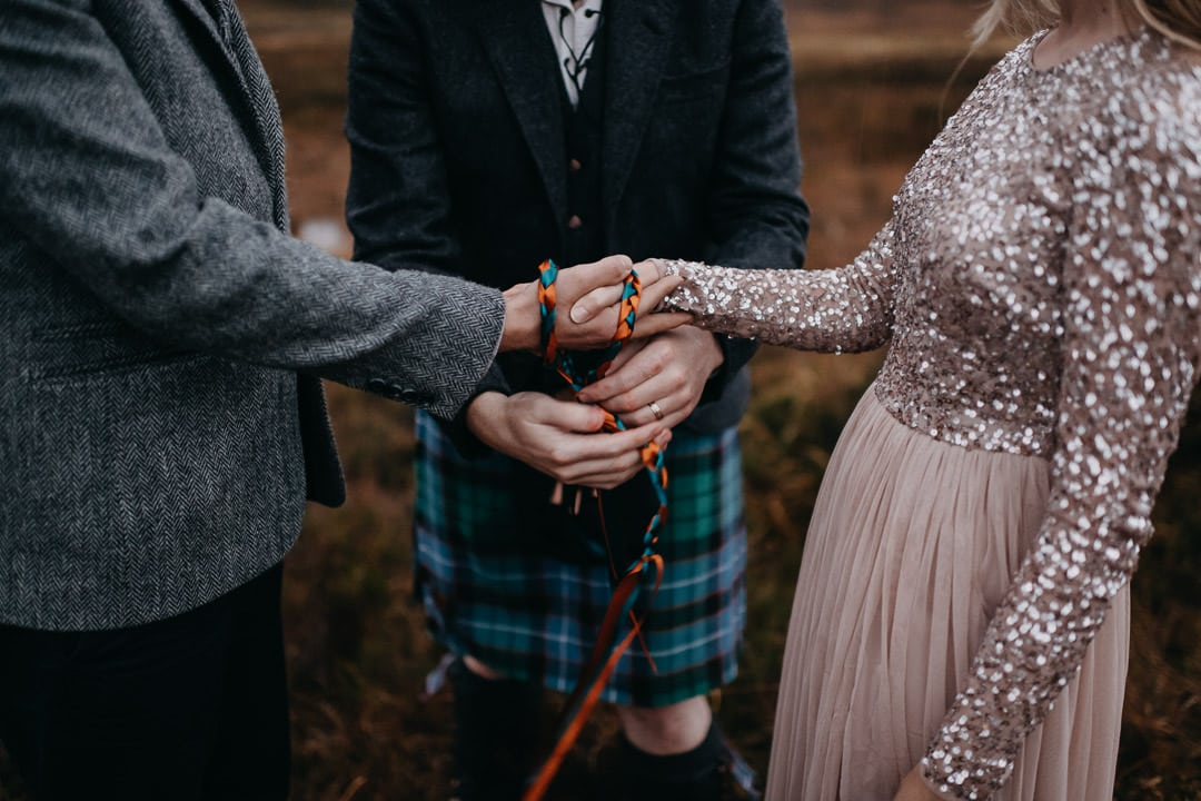 Handfasting cord in Glencoe by kilted celebrant - elopement commitment ceremony