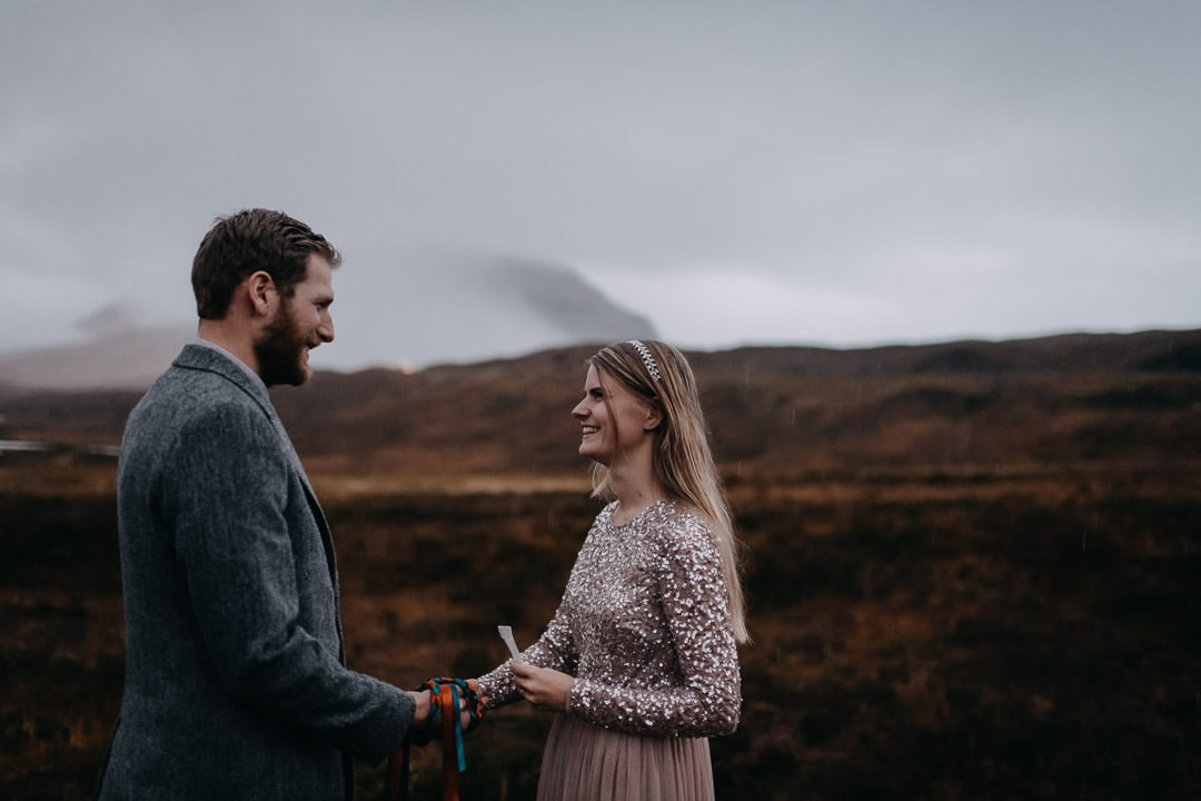 Happy elopement vows in moody foggy Glencoe - Scottish Highlands