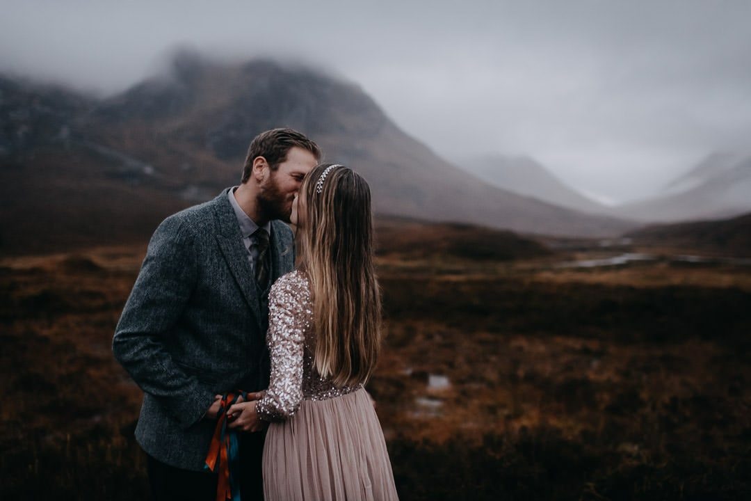 Handfasting ceremony in Glencoe Scotland - kissing couple