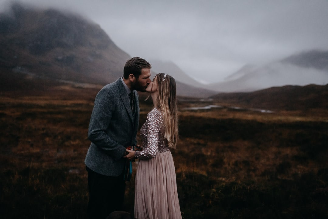 Engagement commitment ceremony handfasting in foggy Glencoe, Scotland in the rain