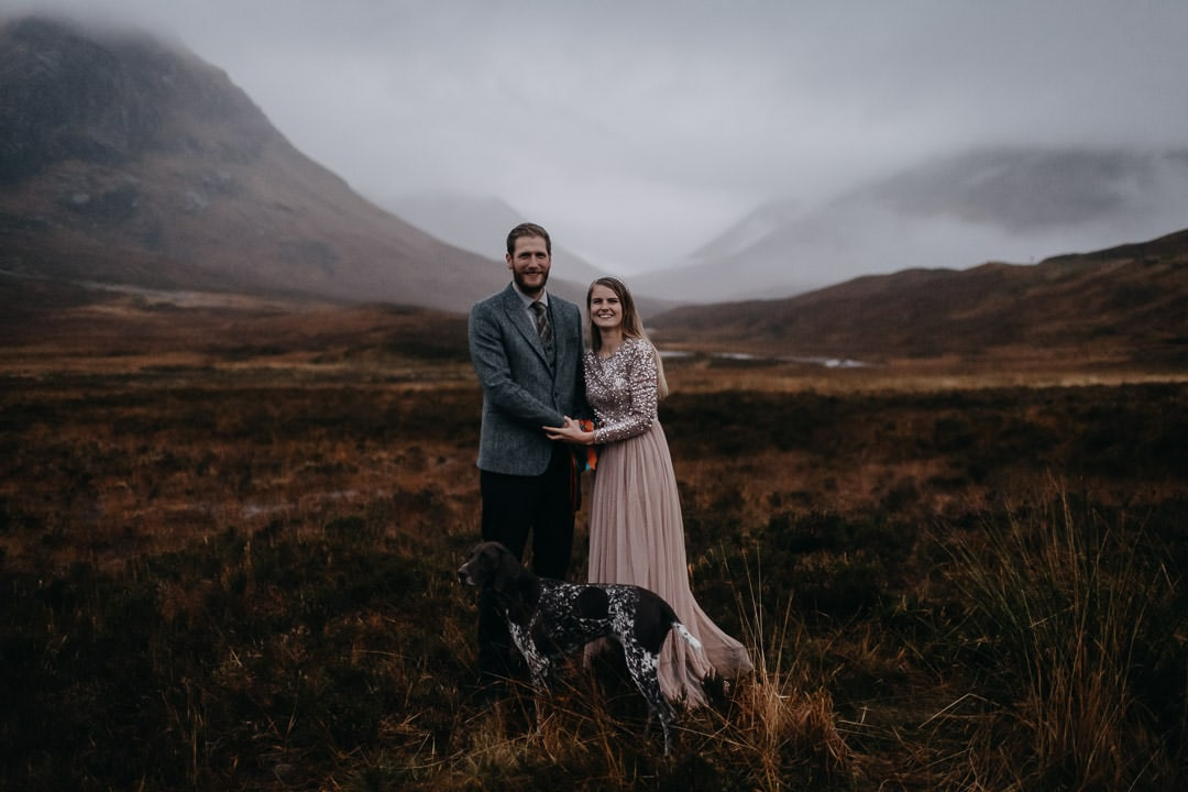 Happy handfasted couple in foogy Glencoe with dog