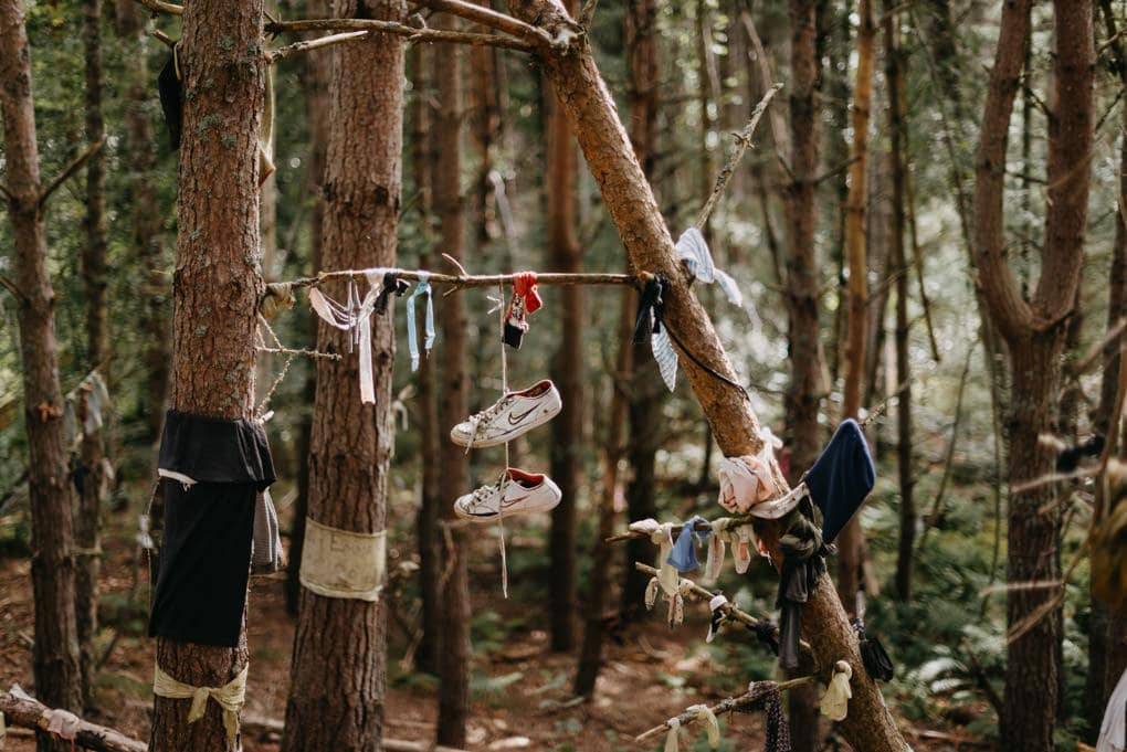 shoes hanging from branch on the clootie well