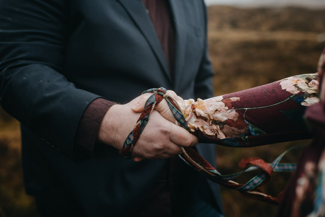 Couples handfasting in Glencoe, Scotland - handfasting cord for scottish elopements in the Highlands