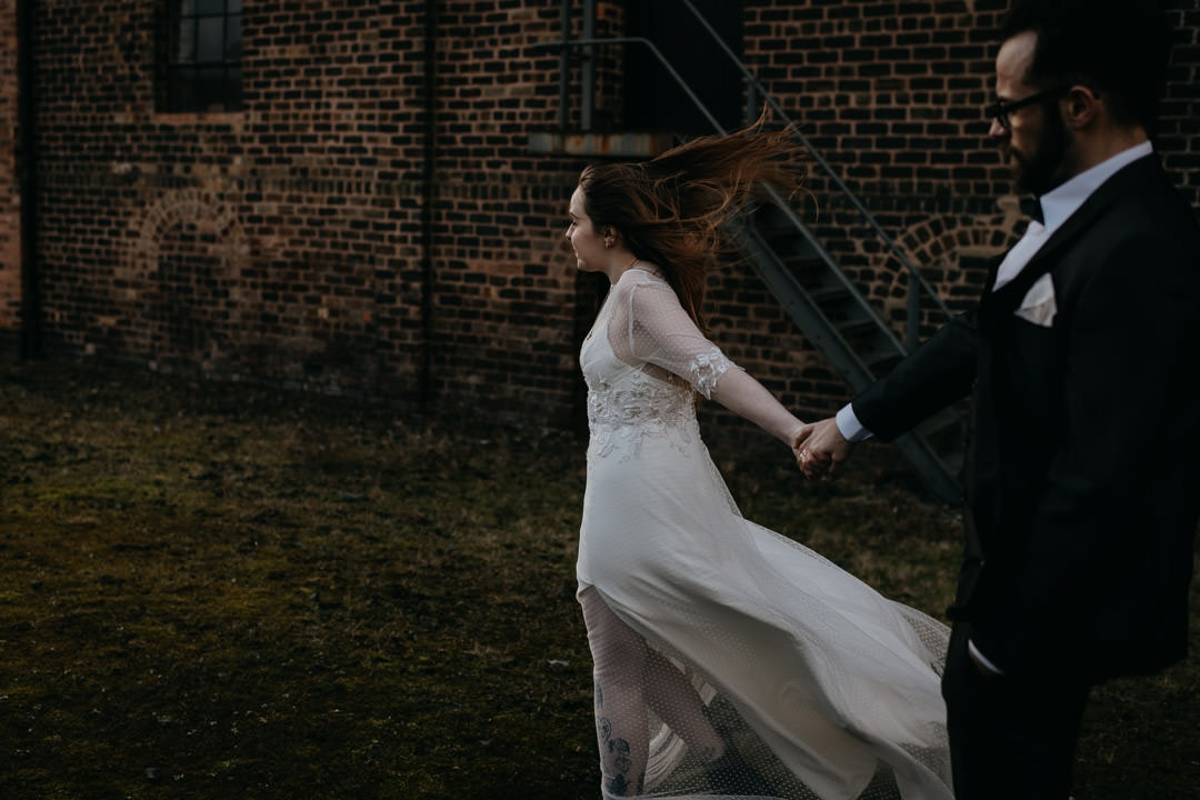 Couple with windy hair outside the Newbattle Mining Museum - Scotland elopement photographer