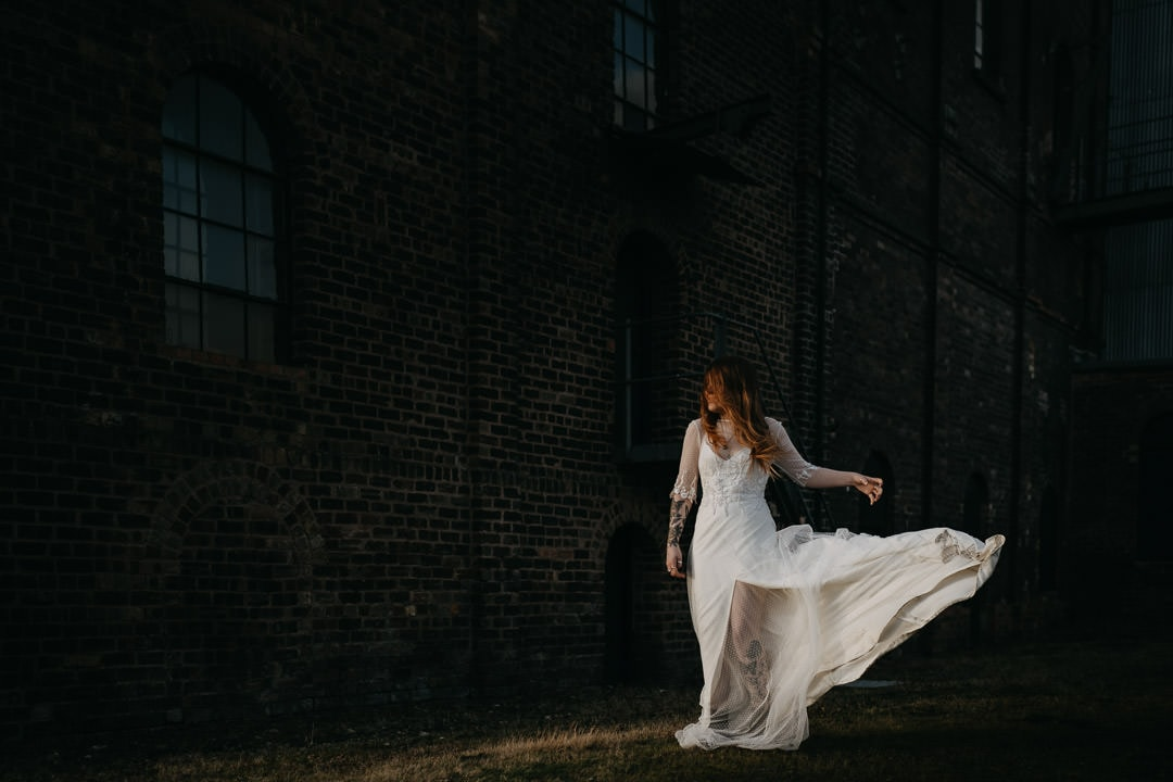 Bride with windy dress outside the Newbattle Mining Museum - Scotland elopement photographer