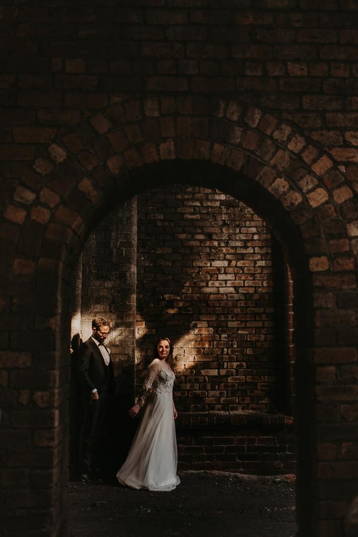 Dramatic photo of wedding couple underneath the National Mining Museum wedding venue - scottish elopement photographer
