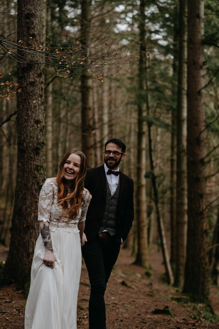delighted couple after eloping to scotland in the forest