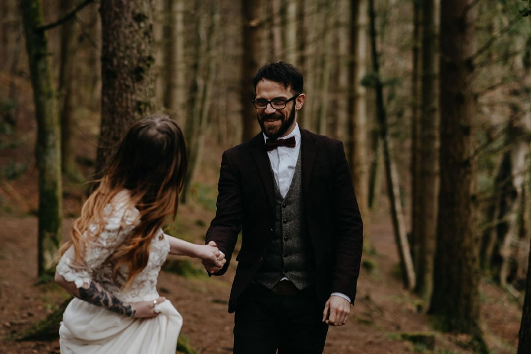 Happy couple during Scottish elopement in the forest - photographer