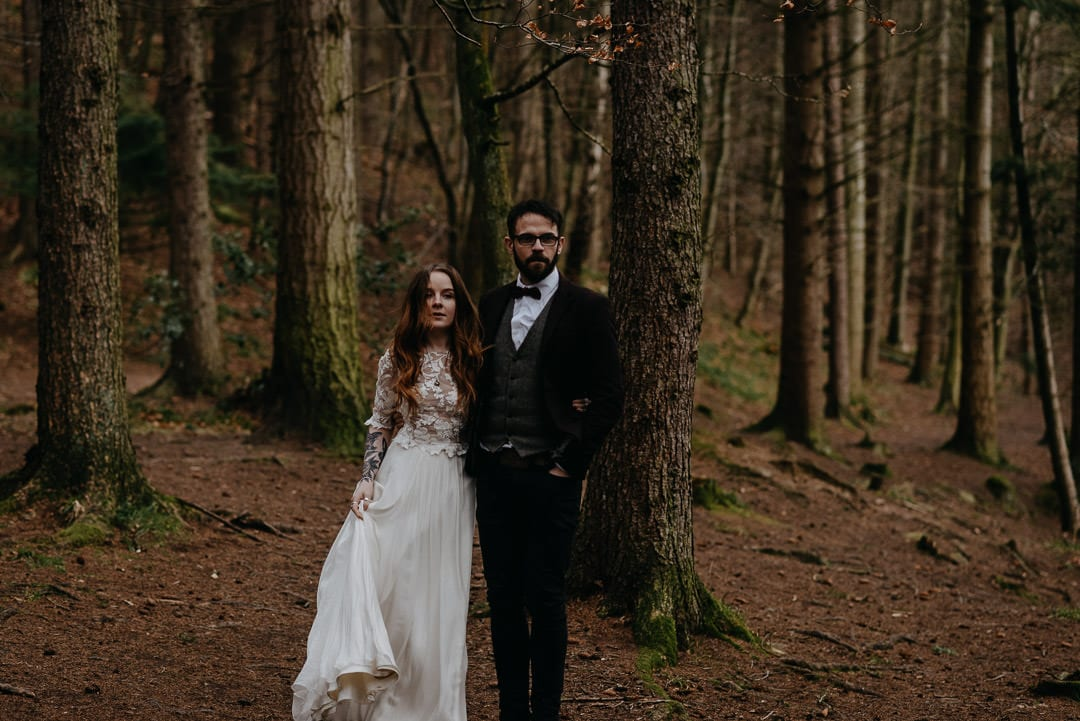 Wedding couple walking through Scottish forest during elopement - Scottish elopement photographer