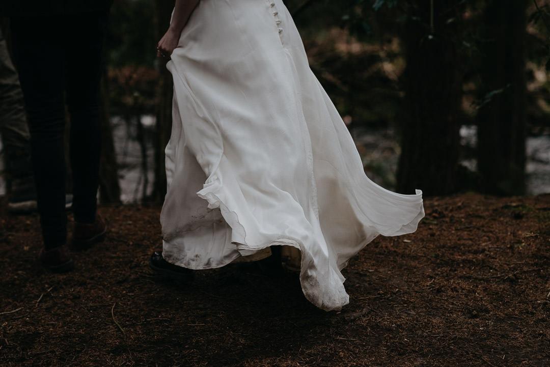 Beautiful windy wedding dress in Scottish elopement