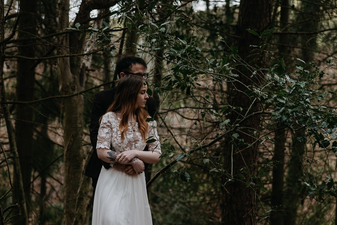 Couple nestled inside trees in Scotland elopement - elopement photographer scotland