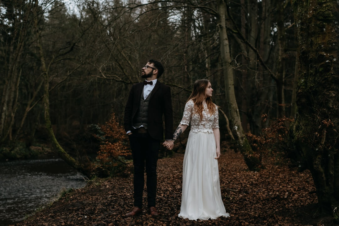 Adventurous couple in Scottish elopement in the woodland with flossy and dossy dress