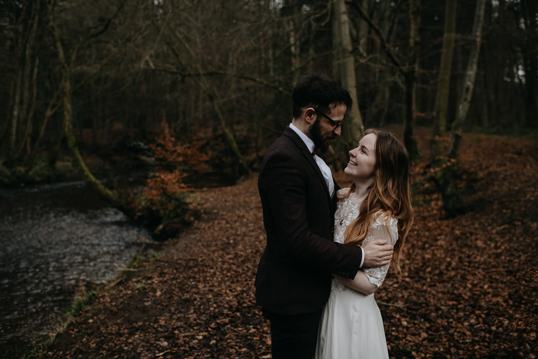 Elopement couple in Scottish woodland looking happy