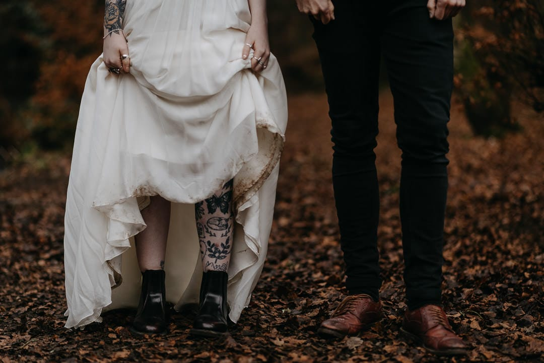 Scottish elopement couples in the woods with dirty dress - adventurous tattooed wedding couple