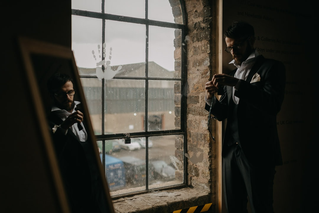 Reflecting groom preparing to elope in Scotland - National Mining Museum