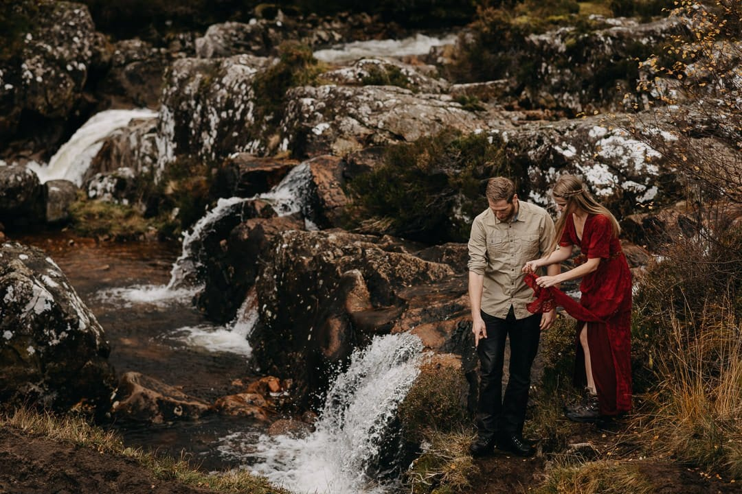 Adventure photoshoot with an engaged couple by Buachaille Etive Mòr in the Scottish Highlands - near waterfalls