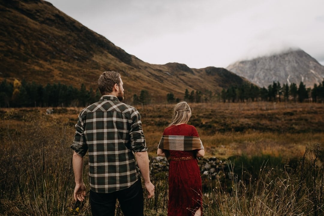 Elopement couple walking through the glens of Scotland - bohemian styled