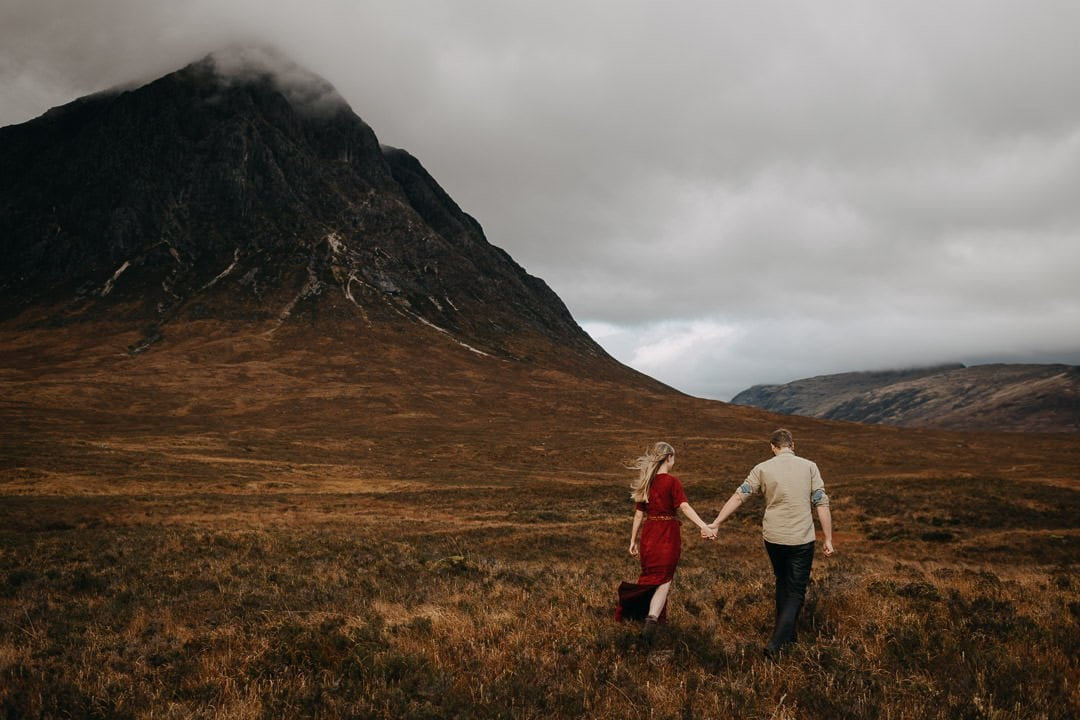 couple walking through the scottish highlands - adventure session near Glencoe