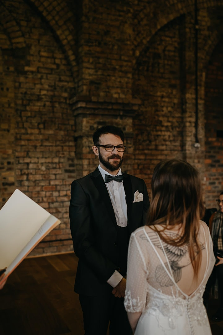 Happy grooms saying vows at quirky Scottish venue