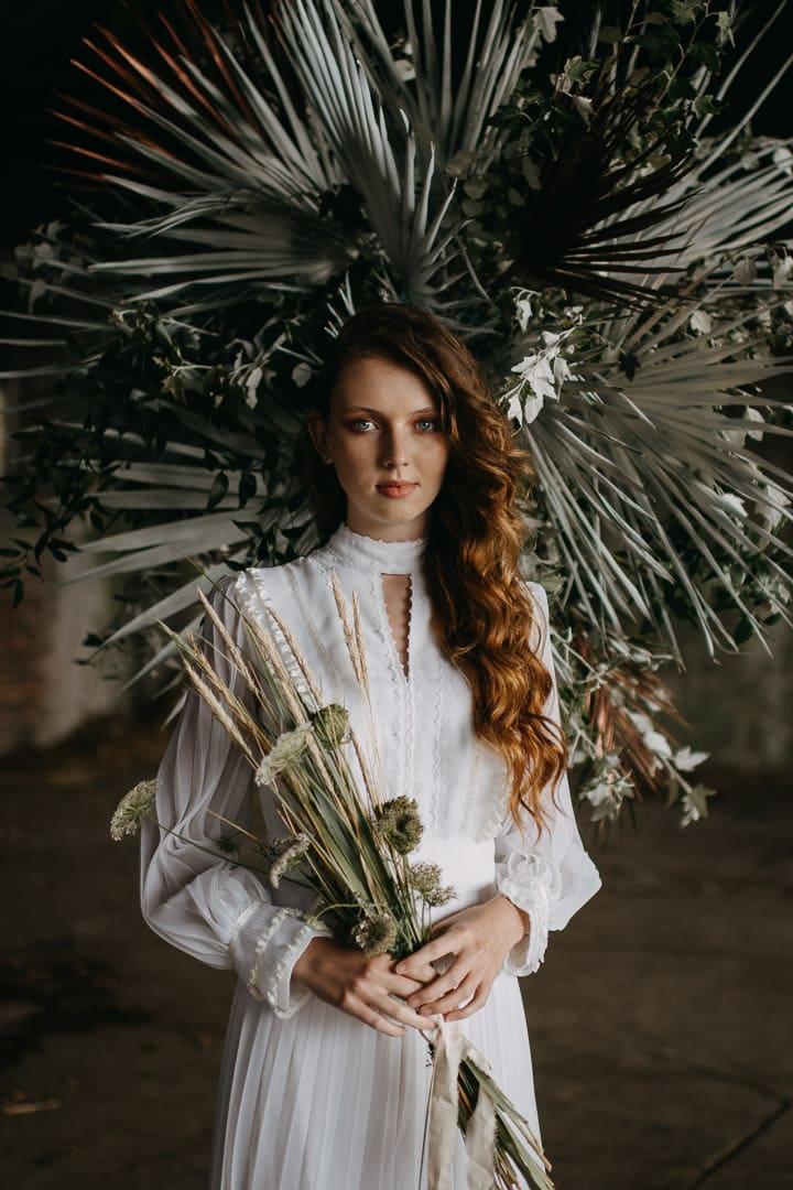 Scottish vintage boho elopement with dramatic florals