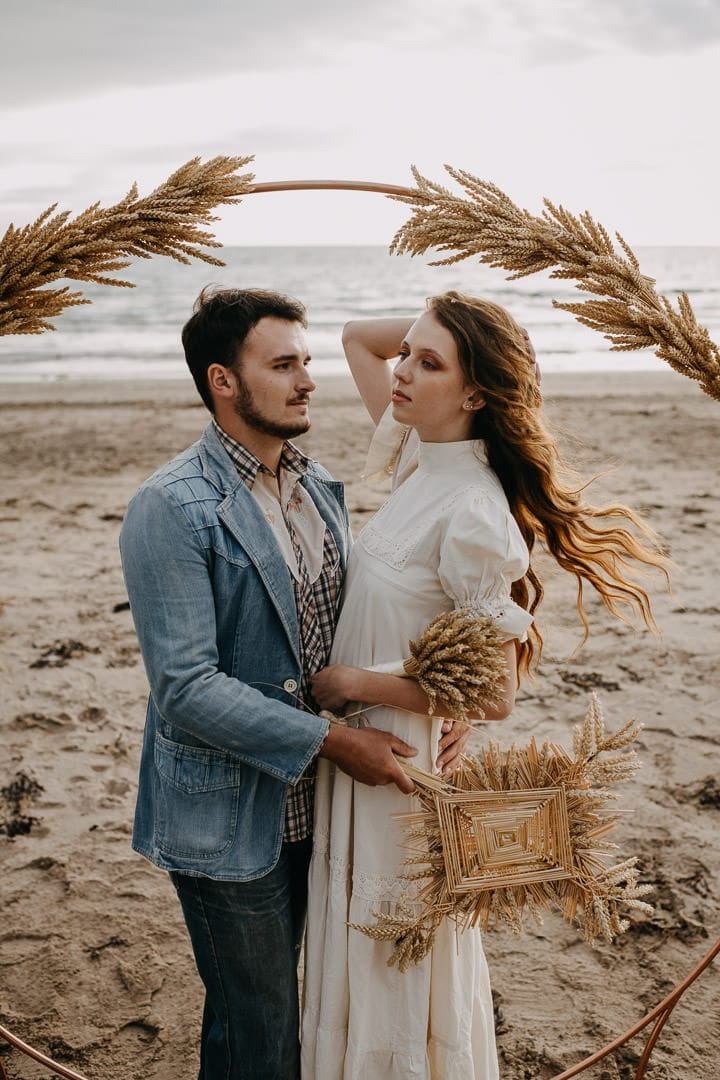 Vintage boho elopement on a Scottish beach with celtic florals