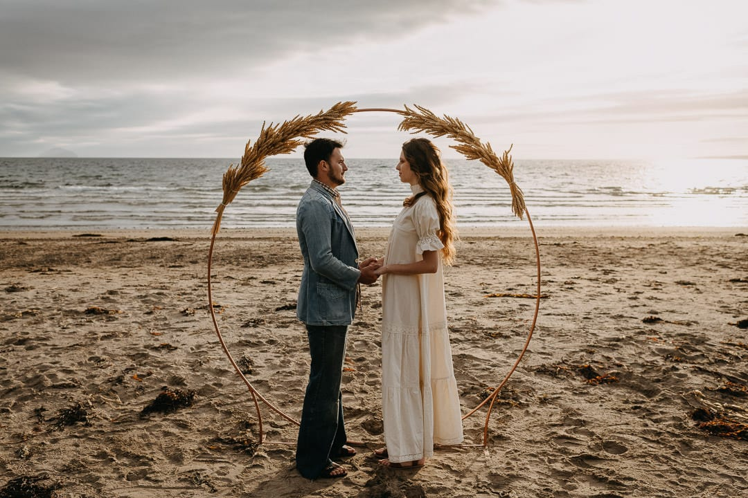 Elopement vows on a Scottish beach - vintage boho style