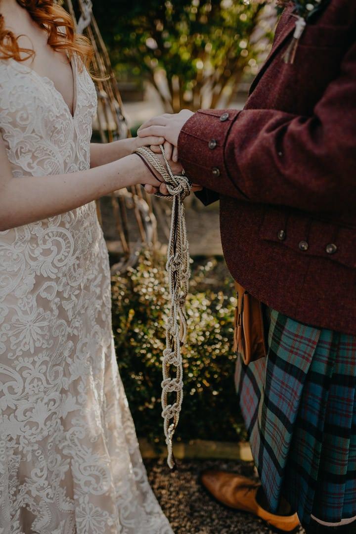 Celtic handfasting ceremony in greenhouse Scottish wedding venue