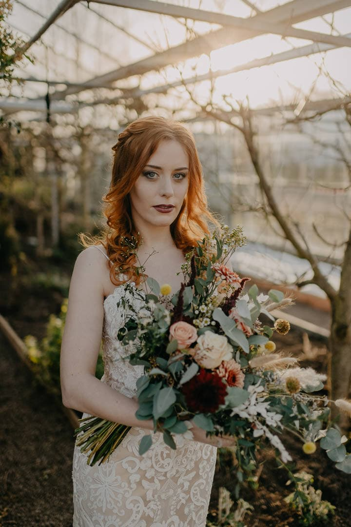 Celtic red-haired Scottish bride in greenhouse elopement