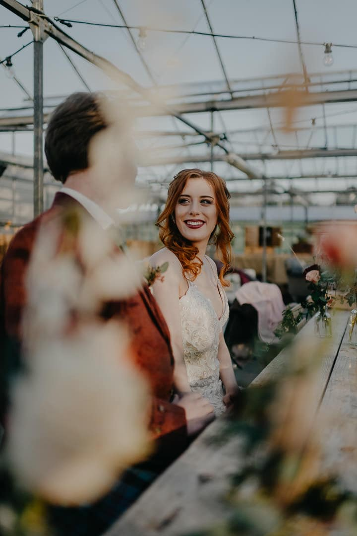 Relaxed moment during Secret Herb Garden elopement - Scottish wedding venue in a greenhouse