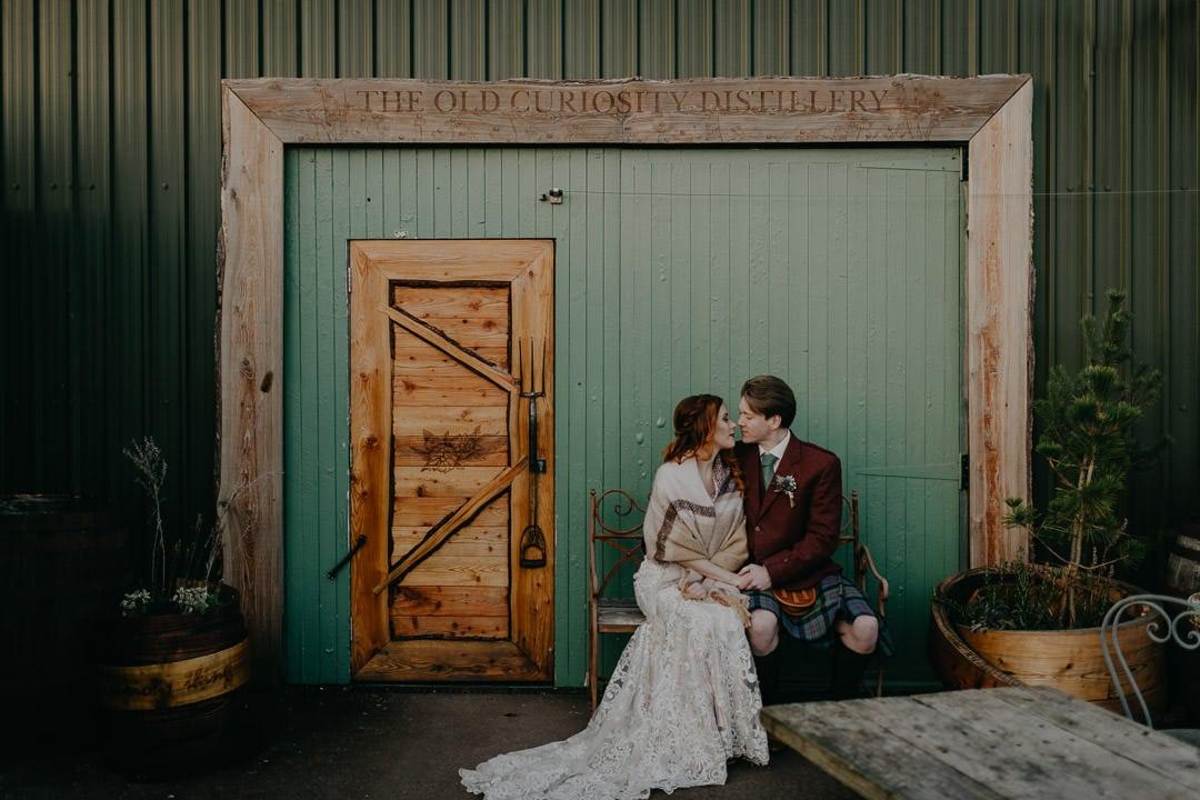 Wedding couple outside the Old Curiosity Gin Distillery near Edinburgh